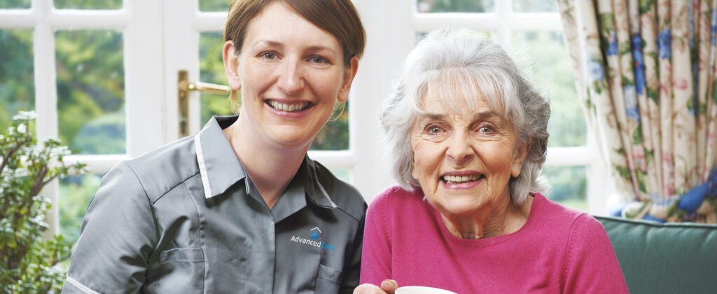 One of Advanced Care's home care assistance sitting with a service user